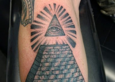 image of all seeing eye tattoo done by Mike Welch of Skin Deep