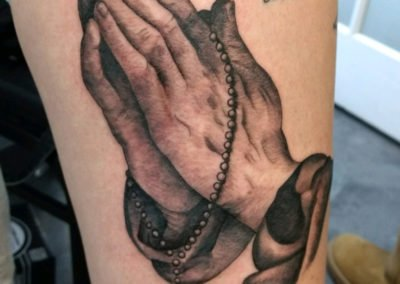 image of praying hands tattoo done by Mike Welch of Skin Deep