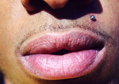 image of man with piercing above his mouth done by Monte Vogel at Skin Deep