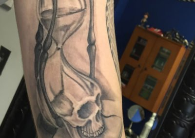 image of skull and sand tattoo done by Shawn Pierce of Skin Deep