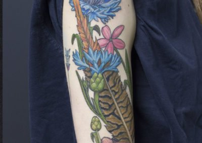 image of detailed flowers tattoo done by Shawn Pierce of Skin Deep