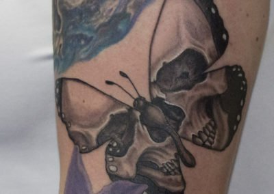 image of skull butterfly tattoo done by Shawn Pierce of Skin Deep