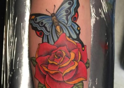 image of flower and butterfly tattoo done by Shawn Pierce of Skin Deep